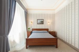 Кровать или кровати в номере Центральный by USTA Hotels
