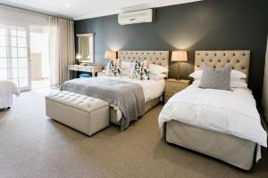 A bed or beds in a room at Mont d'Or Clarens