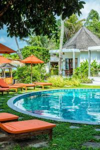 The swimming pool at or near Secret Garden Beach Resort