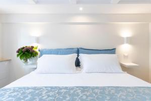 Letto o letti in una camera di Pantheonview - Luxury Suites
