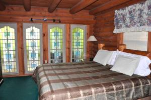Ein Bett oder Betten in einem Zimmer der Unterkunft #2220 Little Wing