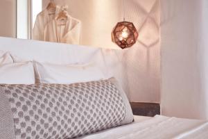 A bed or beds in a room at Mykonos No5 Luxury Suites & Villas