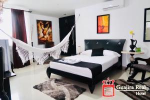 Cama o camas de una habitación en Hotel Guajira Real