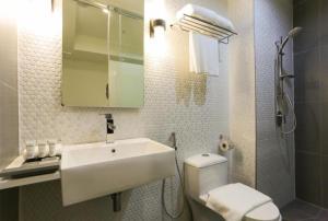 Ein Badezimmer in der Unterkunft Avenue J Hotel, Central Market