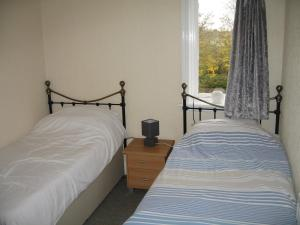 A bed or beds in a room at Newton Brewery Inn