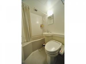 A bathroom at Dormy Inn Matsumoto