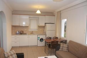 A kitchen or kitchenette at Rose Residence