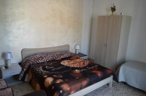 A bed or beds in a room at B&B Olympo
