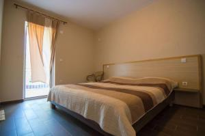 Krevet ili kreveti u jedinici u objektu Apartments Ribarica