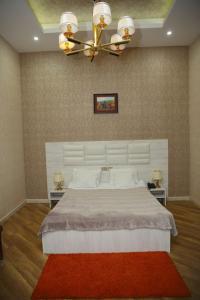 Cama ou camas em um quarto em Royal&Xan Palace