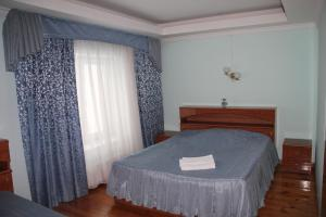 A bed or beds in a room at Galas Hotel