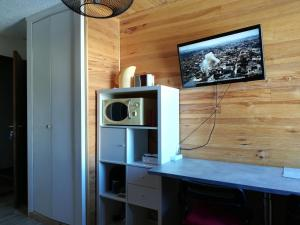 A television and/or entertainment center at Life like a local : Gaspard