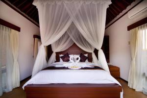 A bed or beds in a room at The Awan Villas