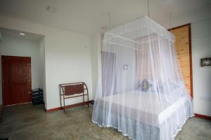 Een bed of bedden in een kamer bij Ella Rawana Den Hotel