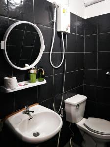 Ein Badezimmer in der Unterkunft Tuk Tuk Guesthouse