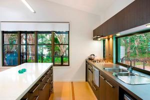 A kitchen or kitchenette at Eumarella Shores Noosa Lake Retreat
