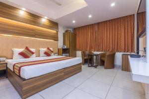 A bed or beds in a room at Rupam Hotel
