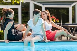 The swimming pool at or near Novotel Breda