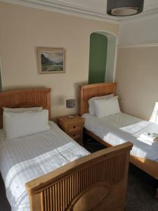 A bed or beds in a room at Mairs Bed and Breakfast.