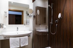 Ein Badezimmer in der Unterkunft Hotel Kapeller Innsbruck