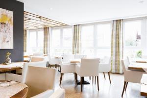 Ein Restaurant oder anderes Speiselokal in der Unterkunft Hotel Kapeller Innsbruck