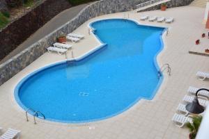 Widok na basen w obiekcie Relax, descanso y una experiencia inolvidable lub jego pobliżu