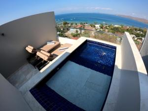 The swimming pool at or close to Bukit Pool Suites Gili Gede