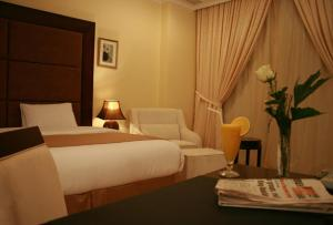 A bed or beds in a room at Palazzo Hotel