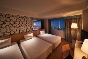 A bed or beds in a room at Tobu Hotel Levant Tokyo