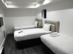 A bed or beds in a room at The Picture House Apartments