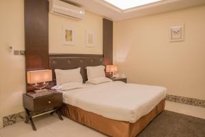 Cama ou camas em um quarto em Alarjan Dream