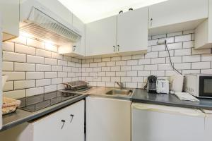A kitchen or kitchenette at Les Berges apartment Disneyland BMYGUEST