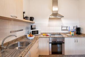 A kitchen or kitchenette at Villas El Partidor