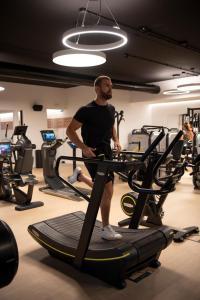 Het fitnesscentrum en/of fitnessfaciliteiten van Art&Park Hotel Union Lido