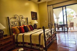 Cama o camas de una habitación en Villa Mariposa Cabo Del Sol