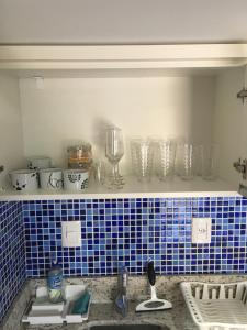 A bathroom at Flat Rios - Conforto em Área Nobre (Centro) - Wifi - Netflix - Privacidade