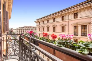 A balcony or terrace at Roma Boutique Hotel
