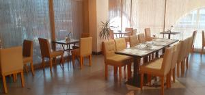 A restaurant or other place to eat at Yinm Furnished Apartment