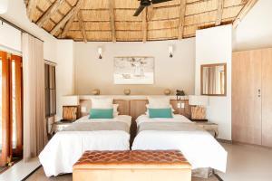 Un ou plusieurs lits dans un hébergement de l'établissement Tambuti Lodge