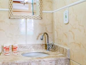 Um banheiro em Hotel Macuco