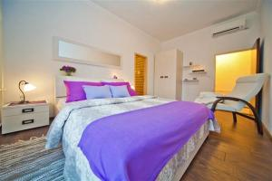 A bed or beds in a room at Villa Gorica a luxury villa in Dubrovnik