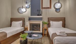 Ένα ή περισσότερα κρεβάτια σε δωμάτιο στο Φρόντζου Πολιτεία