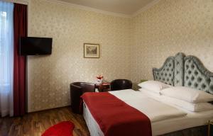מיטה או מיטות בחדר ב-Hotel Urania