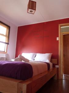 Cama o camas de una habitación en Hostal Morocha
