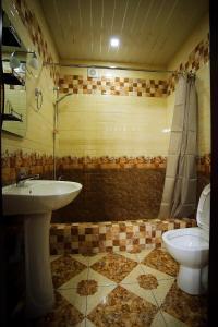 A bathroom at Oasis Villa