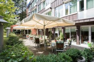 Ein Restaurant oder anderes Speiselokal in der Unterkunft Michels Apart Hotel Berlin