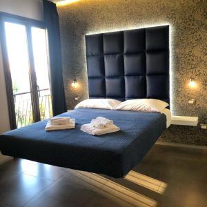 Letto o letti in una camera di Bamboo Luxury B&B