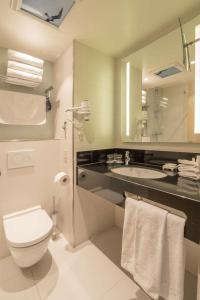 Een badkamer bij Radisson Blu Hotel, Amsterdam City Center
