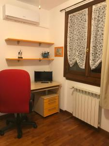 A television and/or entertainment center at B&B IL VIALETTO