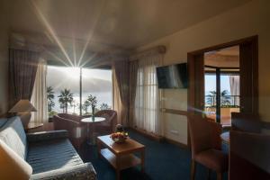Coin salon dans l'établissement Monte Mar Palace Hotel